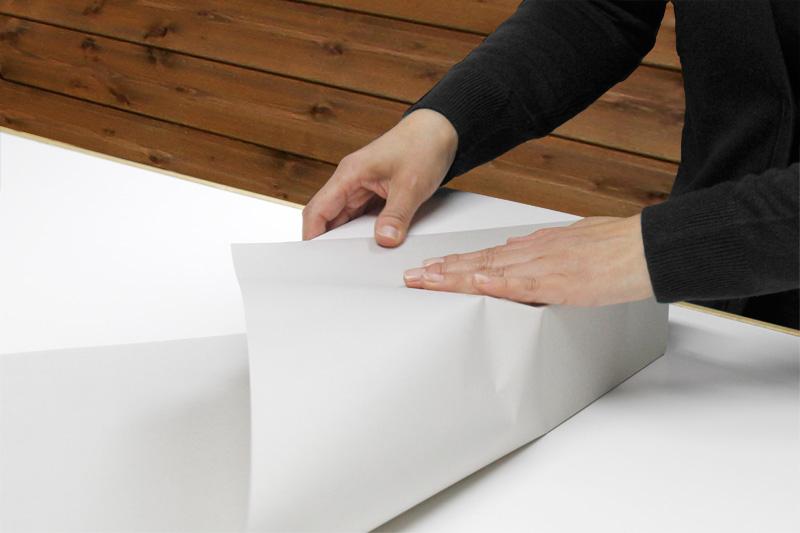 専用の包装紙を使いななめ包み(デパート包み)で梱包